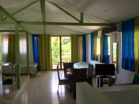 living room of penthouse suite at costa rica hotel for sale