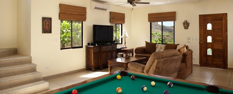 game room at playa conchal beach homoe