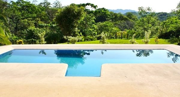 pool view from playa grande home for sale