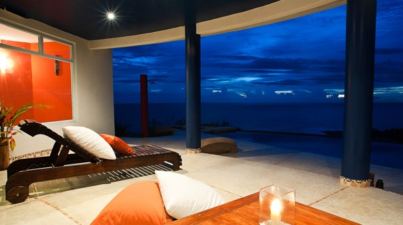 mail pais ocean view home at night
